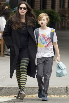 HUMPhooks flush and swivel permanent bag hooks www.humphooks.com On the school run: Liv Tyler wore quirky black and yellow striped leggings as she walked son Milo to school in New York on Monday