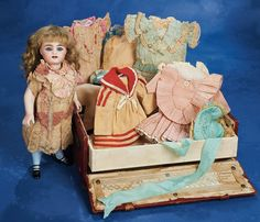 Antique German All-Bisque Doll with Trunk and Trousseau, circa 1890.
