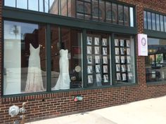 Window display showcasing gowns available at Something White Bridal Boutique - photographs taken by Melissa Cribbs Photography.