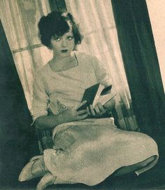 Clara Bow photographed during the reading a book at home, circa. 1928