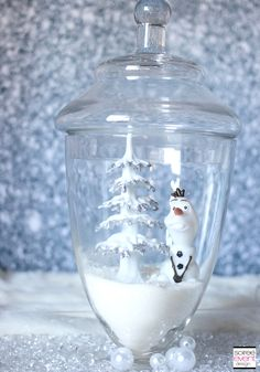 Create wintery Terraniums for a unique decor element for your next Frozen party!  See full party pics here: Soiree-EventDesign.com/blog