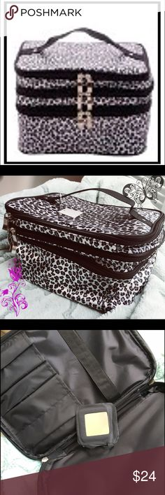 🎃SALE🎃BNWT J FRANCIS SNOW LEOPARD COSMETIC BAG💖 🔥🆕🔥BNWT Beautiful J. Francis Fashion Snow Leopard Print 3 Compartment Cosmetic Bag. Three different levels in one bag. Top level has pockets for brushes and a small mirror that is included. Excellent value!💖🌺 J. Francis Bags Cosmetic Bags & Cases