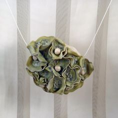 sea treasures - polymer clay hand crafted pendant. Sterling silver/stainless steel strand with sterling silver magnetic clasp.