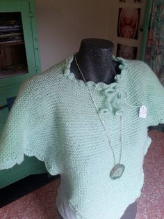 Green hand knitted pixie poncho shawl neon pastel with scalloped collar and bow tie with circle ends.. $20.00, via Etsy.