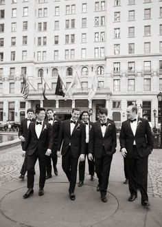 Groom Walking with Groomsmen in Tuxes | Photo: Ira Lippke Studios. View More:  http://www.insideweddings.com/weddings/high-school-sweethearts-say-i-do-at-the-plaza-in-new-york-city/914/