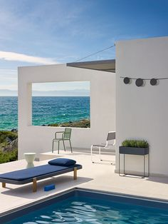 'Rams' sun bed, €5,527, by Victor Carrasco, for Paola Lenti. 'Prince Aha' stool, €79, by Philippe Starck, for Kartell, from Oikos. 'Tykho Booster' bluetooth speaker, €139, by Marc Berthier, for Lexon. 'Palissade' armchair, £179, by Ronan & Erwan Bouroullec, for Hay