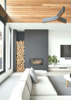 Want to get a perfect living room wall color? Try one of these latest living room wall colors Here you can find some of the living room wall color schemes Inset Fireplace, Modern Fireplace, Fireplace Design, Decorative Fireplace Logs, Scandinavian Fireplace, Bloomfield Homes, Chimney Decor, Room Wall Colors, Interior Architecture