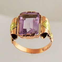 Gorgeous deco setting is 14 karat pink gold with yellow gold trim on each side. Pretty pink amethyst stone accents the colors of the gold. Unique!