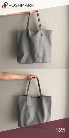 Gray Tote Brand new without tag. Faux leather. Grey tote with outer pocket. Similar to Madewell Transport tote. Small scuff on bottom as shown in second photo.blue mark as shown in third photo. Overall excellent condition Bags Totes