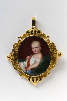 Brooch  Made in France between 1811-1900  Enamel and gold, artist unknown.  François Joseph Charles Bonaparte, son of Napoleon I and his second wife, Archduchess Marie Louise of Austria, was named the 'King of Rome' by his father when he was born in 1811. At Napoleon's first abdication during the downfall of the empire in 1814-15, François briefly became Emperor Napoleon II, but in name alone.