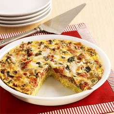 Tomato and Spinach Hash Brown Pie: A savory hash brown recipe with seasoned tomatoes, fresh spinach and Italian blend cheese for a baked vegetarian main dish