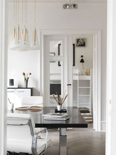 White walls, chic furniture and cool lighting add up to mature modern style in this Copenhagen apartment Black And White Furniture, Black And White Living Room, Copenhagen Apartment, Condo Remodel, White Houses, White Walls, Kitchen Interior, Contemporary Furniture, Modern Decor