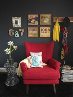 Like the dark grey wall and red furniture for the sitting/family room -- not the old timey wall hangings though.