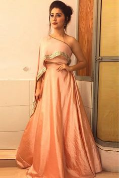 The Stylish And Elegant Lehenga Choli In Peach Colour Looks Stunning And Gorgeous With Trendy And Fashionable Embroidery .The Art Silk Fabric Party Wear Lehenga Choli Looks Extremely Attractive An. Indian Wedding Gowns, Indian Gowns Dresses, Indian Fashion Dresses, Dress Indian Style, Indian Designer Outfits, Pakistani Dresses, Pink Gowns, Wedding Dresses, Gown Dress Party Wear
