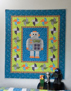 Robot-O-Matic Baby Quilt Kit by Kristin Gassaway.  Piecing and applique.  40 x 46 inches.