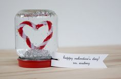 Make a valentine that they'll treasure forever. While Dandee Designs' snow globes may seem complicated, they only require a few supplies that you can find around the house.  Source: Dandee Designs