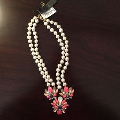 J. Crew Pearl Statement Necklace Beautiful pearl necklace with pink, peach, blue and rhinestone accents. Never worn and with original tags and keep safe bag. Will look great with any outfit! J. Crew Jewelry Necklaces