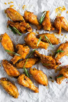 These pineapple mango habanero chicken wings are the perfect summertime appetizer or easy dinner! They're a delicious mix of sweet and spicy and can be made in your oven or the grill. It's time to give into your chicken wing cravings! Baked Chicken Wings, Chicken Wing Recipes, Chicken Tenders, Fried Chicken, Great Recipes, Favorite Recipes, Dinner Recipes, Turkey Recipes, Recipe Ideas