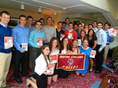 Tech Trek students pose for a picture with their newly signed books by author Andy Kessler.
