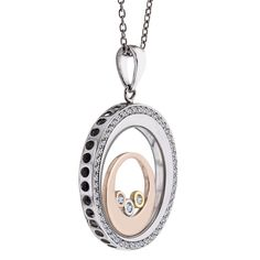 From WYS Jewelry: Oval pendant necklace in 14k white, yellow, and rose gold with 0.17 ct. t.w. diamonds, $1,275