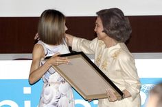 Queen Letizia handing her mother-in-law, Queen Sofia, the Joaquín Ruiz-Giménez 2015 prize in acknowledgement of Sofia's dedicated work protecting the rights of the most vulnerable, including children.