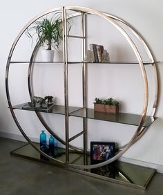 1970s Circular Two-Piece Brass Étagère with Smoked Glass Shelves   From a unique collection of antique and modern shelves at https://www.1stdibs.com/furniture/storage-case-pieces/shelves/