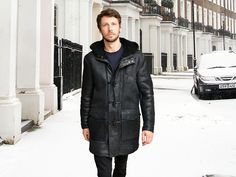 Denny (men's Black Sheepskin Duffel coats  £475.00) . NEW GENERATION MEN'S SHEEPSKIN COATS!  Modern take on the classic style men's Sheepskin duffel coats.  Made from heavy quality extra durable soft supple semi Nappa (Leather) Antique Black shade Sheepskin.  The Sheepskin hood can be buttoned high in the neck or turned down away from the face as pictured. Straight easy cut body and sleeves, deep plunge pockets with matching flaps that can be fastened with concealed metal press studs.