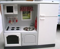 Old entertainment center made into little kitchen