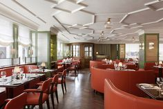 """""""The ceiling showcases an Edwardian-inspired patterned bead, which works perfectly with the theme of blending old and new,"""" says Martin Brudnizki of 45 Jermyn St., the London restaurant he designed in the former Fountain space. """"The traditional oak parquet flooring, rosewood tables and neutral-swathed curtains, alongside the low yet distinctive ceiling, complement the silver walls, composed of textured glass bonded to mirror to create a reflective and modern texture."""""""