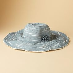 """RIBBON ROSETTE HAT--Don this bloom-bedecked, ribbon-woven hat, shape the wide wire brim as you like and protect that pretty face of yours. 50  UPF. Polyester. Imported. 5"""" brim."""