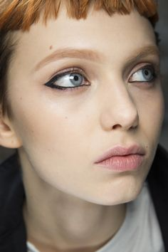 Diane Kendal created a graphic black liner look at Emilio Pucci, complemented by clean skin and a little cream shadow around the eyes.