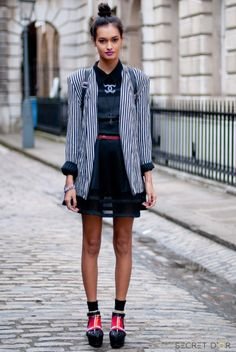 Socks and sandals, tick.  Monochrome, tick.  Purple lips, tick.  Gizele Oliveira's outfit is perfectly on trend. #LFW #StreetStyle