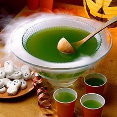 Brew-Ha-Ha Punch - Halloween Party Appetizers and Finger Food - Southernliving. Recipe:Brew-Ha-Ha Punch  This sweet punch is a crowd-pleaser, is easy to make, and it tastes great. You'll enjoy the fruity flavors of pineapple and lime, and the fizz of ginger ale will add zest to this this fun and spooky beverage. For Halloween, you must be sure to plan a scary presentation. Just place your punch bowl into a larger bowl, and add dry ice to the larger bowl. You'll have smoke under your punch…