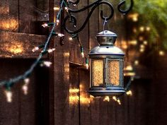 pretty lanterns. This would be perfect for our fence in the backyard. Up high enough too that Diesel Boy won't get them.