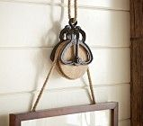 Use old pulley to hang art (this one is from Pottery Barn kids) (maybe paint and destress and desired)