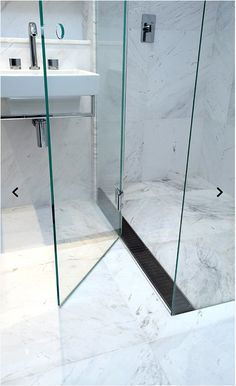 Genial No Need For A Center Floor Waste, Put In This Side Infinity Drain That  Blends In Nicely With The Floor And Wall Tiling And Pivot Glass Door.