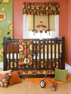 Baby Girl Nursery, flowers, I like that it's not the typical pink and green shades used for a girl's room.