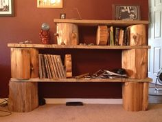 DIY Bookshelf. Tree stumps, planks. Wooden bookends. Easy. Beautiful. Outdoorsy.