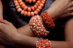 Antonino De Simone. Bracelets: pink coral mounted on silver-based knitted. Necklace: 3 strands of coral washers