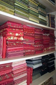 I organized my entire fabric stash like this, with the exception that all of my Reproduction Civil War fabrics are organized on a shelving unit by themselves. Quilt Storage, Craft Room Storage, Fabric Storage, Fabric Boxes, Fabric Basket, Craft Rooms, Sewing Spaces, My Sewing Room, Sewing Rooms