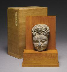 A GANDHARAN SCHIST FACE OF A BODHISATTVA 2ND / 3RD CENTURY