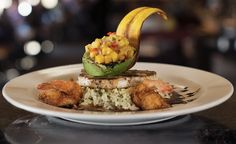 Jerk Seasoned Pacific Swordfish and Coconut Prawns with coconut-cilantro rice, grilled avocado, mango chutney and caribbean plantain sauce  http://scottsseafood.net/theriver/menu-item-type/dinner-menu/