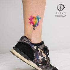 Watercolor hot air balloon tattoo by Koray Karagozler