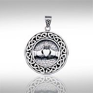 Celtic Knotwork Claddagh Silver Pendant TP195 - The Claddagh is an ancient symbol of friendship, with outstretched hands, love, with a heart, and loyalty, with a crown. This silver pendant also features an intricate Celtic knotwork border. Makes an elegant gift for yourself or someone special!