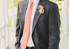 The groomsmen, ushers, and male family members will have boutonnieres of peachy-pink spray roses wrapped in black ribbon all the way down.