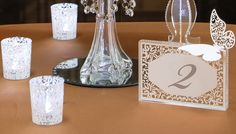 Acrylic table number with rhinestones and butterfly