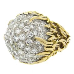 Diamond Gold Cluster Cocktail Ring   From a unique collection of vintage cocktail rings at https://www.1stdibs.com/jewelry/rings/cocktail-rings/