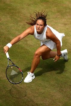Daria Kasatkina of Russia plays a forehand against Alison Van Uytvanck of Belgium during their Ladies' Singles fourth round match on day seven of the Wimbledon Lawn Tennis Championships at All England Lawn Tennis and Croquet Club on July 9, 2018 in London, England.