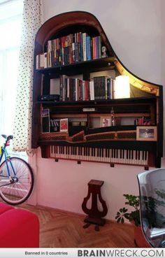 An old piano made into a bookshelf