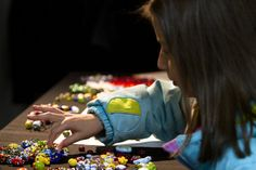 Journey Beads: New program provides glass badges of courage for pediatric cancer patients | Journey Beads was launched Wednesday night with a reception at the West Michigan Glass Arts Center, which is creating hand-crafted beads that children will collect as they go through treatment.